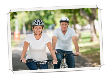 A man and a women riding bikes