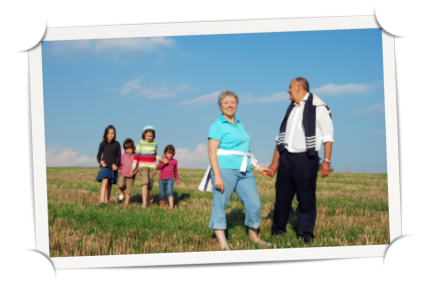 Family walking in a field of grass